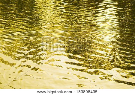 Abstract Background Of Rippled Water Toned Golden Yellow