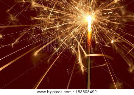 Burning sparkle close up on dark background