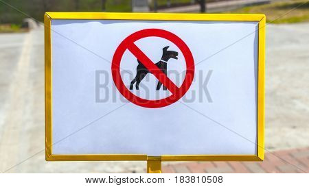 The Sign Prohibiting Walking Dogs in a Park. Warning - Dogs are not Allowed to Walk.