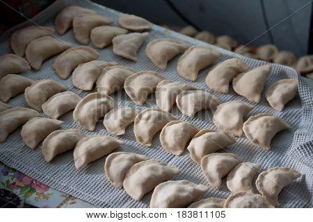 Vareniki dumplings , pierogi before boiling - traditional Ukrainian food