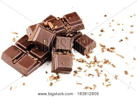 Pieces of dark chocolate bar cubes sprinkled with grated chocolate isolated on white background.