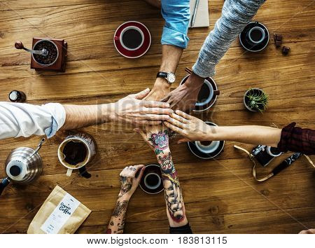 Group of people holding hand assemble together with coffee in aerial view
