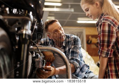 See this thing. Engaged charismatic clever child being fascinated by vintage vehicles while her dad explain her how they working
