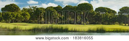 Golf course with lake and trees in Belek Turkey
