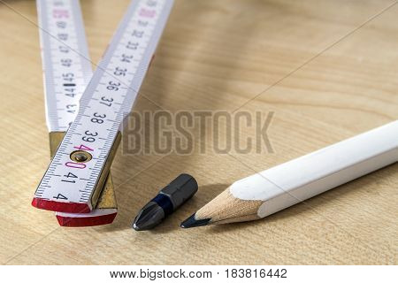 Measuring tape meter and pensil. Construction tools.
