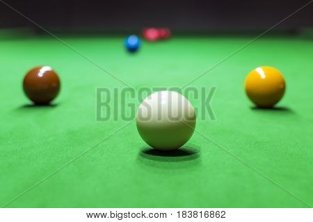 Snooker table and snooker ball close up
