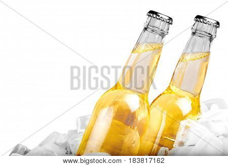 Bottles of cold and fresh beer with ice isolated on white