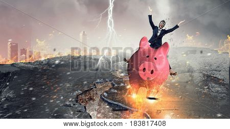 Young businesswoman riding on piggy bank, isolated on white. Saving concept