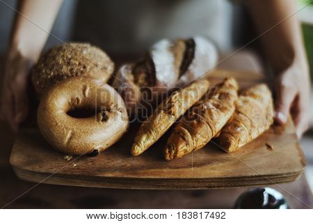 People serve the fresh homemade pastry