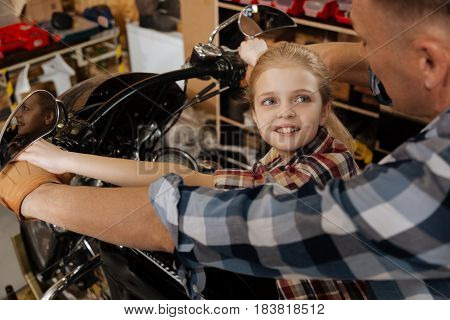 I have an idea. Inspired eager sympathetic girl talking to her dad about her ideas while thy sitting on a bike and planning future rides