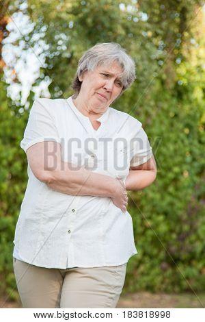 Senior woman suffers from backache