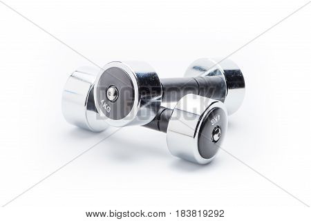 Metallic Dumbbells Isolated On White. Equipment Sport And Healthy Living Concept