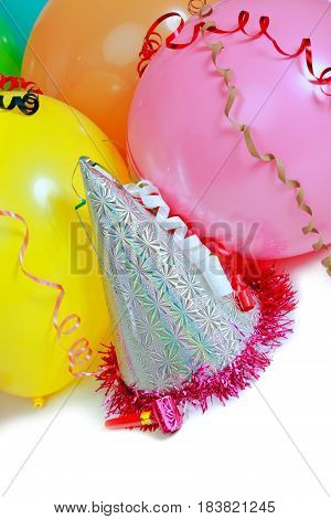 Party Horn Blower, Streamers, Birthday Hat And Balloons Close-up