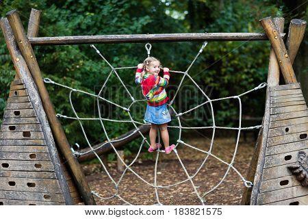 Child Having Fun On School Yard Playground