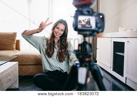 Young Woman Recording Content For Her Blog.