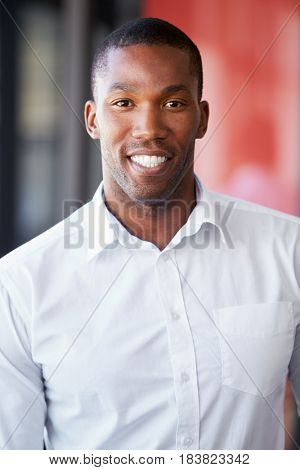Vertical portrait of young black man smiling