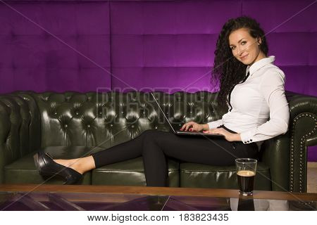 Beauty young adult attractive sensuality and sexy pretty brunette businesswomen working on tablet on luxury retro vintage style sofa at home