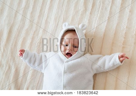 Cute Baby on a Bed in a Jacket