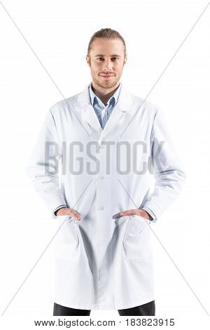 Young Doctor In White Coat Looking At Camera Isolated On White
