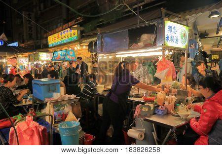 TAIPEI TAIWAN - DECEMBER 7, 2016: Unidentified people visit Song Shan Raohe Night market. Raohe Night market is one of the oldest night markets in Taipei.