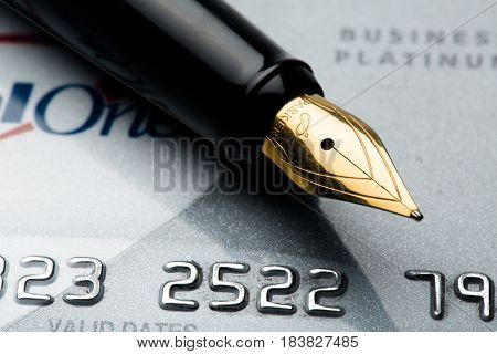 Credit card with a fountain pen on top