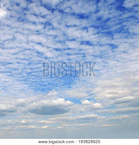 Light cumulus and cirrus clouds in the blue sky.