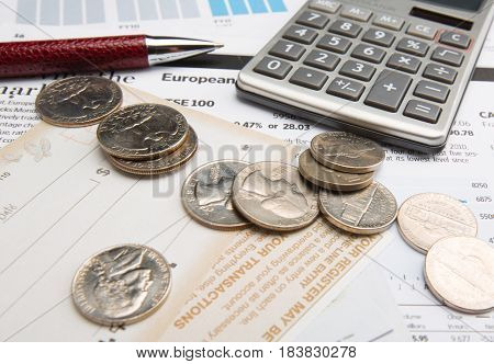 Coins, Calculator, Pen And Check Templates On Financial Reports Close-up