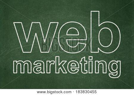 Web design concept: text Web Marketing on Green chalkboard background