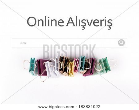 Online alışveriş (Online shopping) in Turkish language. E-commerce online shopping concept. Miniature of reusable grocery bags.