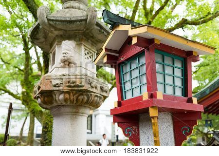 Japanese stone and wooden lantern in temple