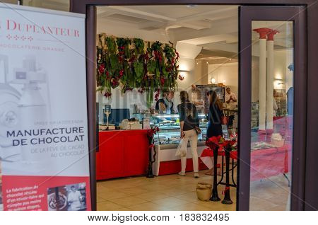 Grasse France. June 6th 2016. Females buying chocolate from a local chocolaterie shop in the city center of Grasse.
