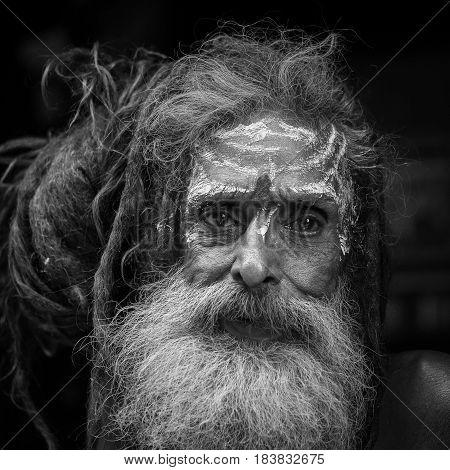 KATHMANDU NEPAL - OCTOBER 25 2016 : Portrait of Shaiva sadhu holy man in Pashupatinath Temple . Close up. Black and white