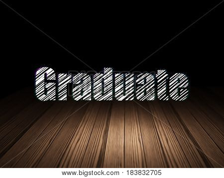 Education concept: Glowing text Graduate in grunge dark room with Wooden Floor, black background