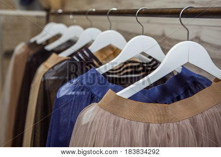 Skirts hang on a hanger in a fashion store
