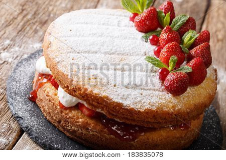 Victoria Sandwich Cake, Decorated With Strawberries, Cranberries And Mint Closeup. Horizontal