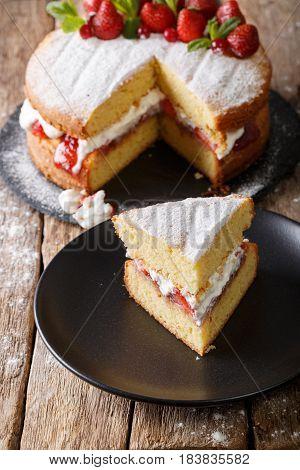 Sliced Victoria Sponge Cake Closeup On A Plate. Vertical