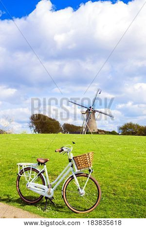 Bicycle and windmill. Symbols of the Netherlands. Tourism bicycle tour cycling bicycling bicycle travel concept.