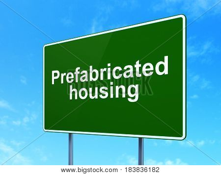 Construction concept: Prefabricated Housing on green road highway sign, clear blue sky background, 3D rendering