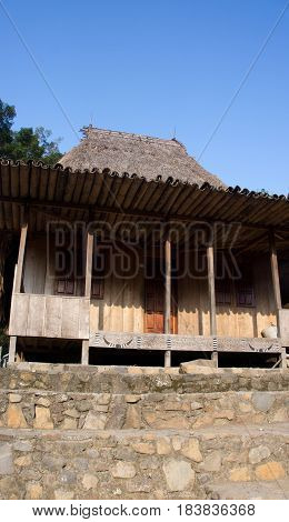 Front of wooden house in Bena a traditional village with grass huts of the Ngada people in Flores near Bajawa Indonesia.