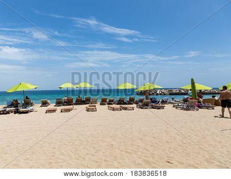 Sunbathers On St Maarten Beach
