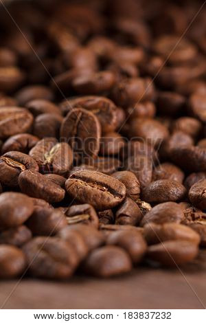Coffee Beans Roasted On Wood Background, Macro