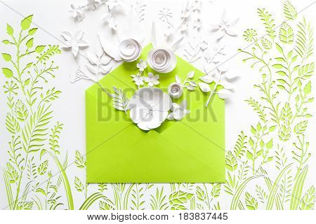 Opened Craft Paper Envelope Full Of Spring Blossom Sakura Paper Flowers On White Background. Top Vie