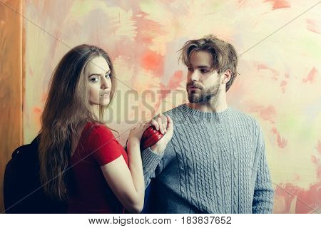 Bearded Man Looking At Pretty Girl With Backpack