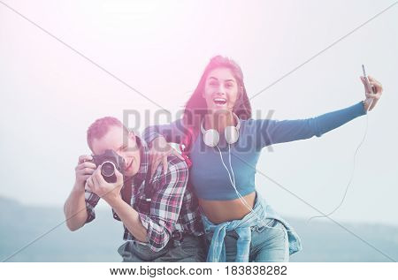 Smiling Girl Taking Selfie With Smartphone And Photographer Photographing