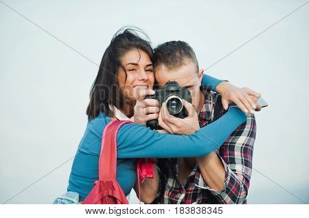 Happy Girl Hugging Handsome Man With Camera