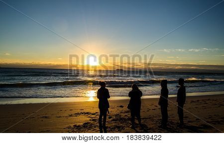 People in Silhouettes at Miami Beach Sunrise