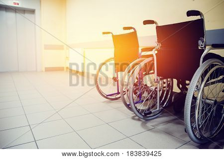 wheelchair is in the hospital near the elevator. Concept assistance in the movement.high contrast and monochrome color tone. Toning.