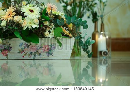 Blossoming Flowers And Green Plants In Wooden Flowerpot