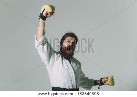 Bearded Shouting Happy Karate Man In Kimono And Boxing Gloves