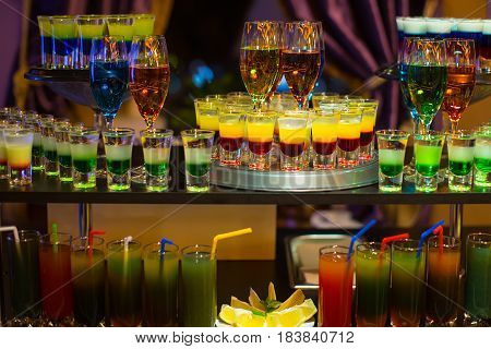 Variety Of Multicolored Cocktails And Layered Shots